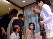 Skinny Japanese chick in a blindfold and latex sling gets her pussy stimulated with mini-vibros and fucked with a carrot