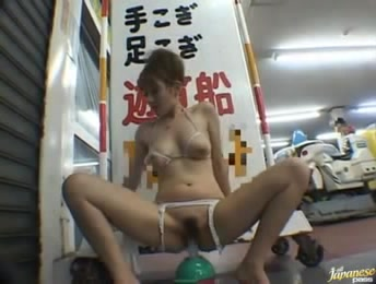 Hot Asian MILF In Lingerie With Her Tits Out Mounting A Dildo On The Floor In The Public Place