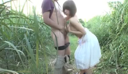 Marvelous Girl In White Dress Gives Out A Blowjob Till He Cums At The Garden