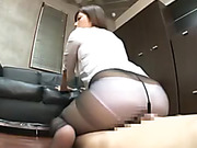 Seductive Asian babe in a white blouse and pantyhose rubbing her boss' cock with her pussy