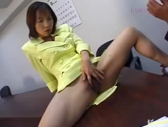 Dirty Japanese Bitch In A Yellow Jacket Rubbing Her Snatch On The Table Of The Office In Front Of Her Colleague