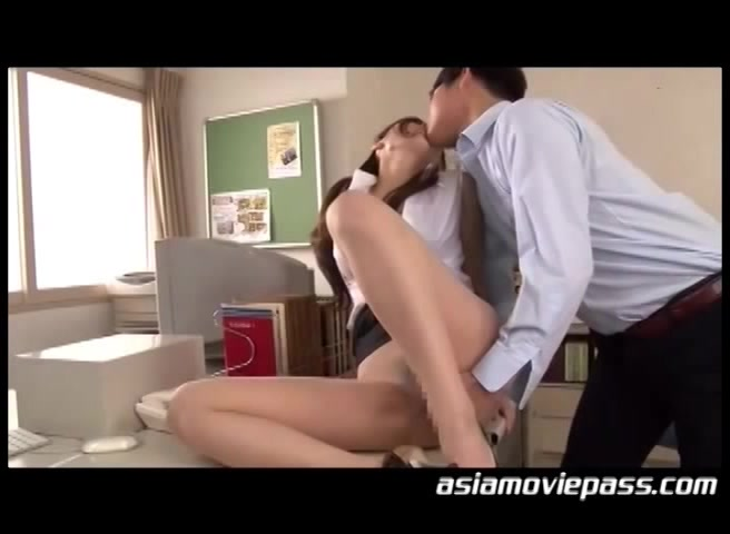 Ponytailed Asian Babe In An Orange Sling And High Heels Enjoys Sitting On A Sybian