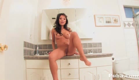 Lovely Asian Displays Her Perfect Tits In A Gray Jacket Then She Takes It Off And Shows Her Big Booty In A Pink Thong Before She Strips It Down And Masturbates As She Rubs And Fingers Her Pussy On A Toilet Seat In A Bathroom.
