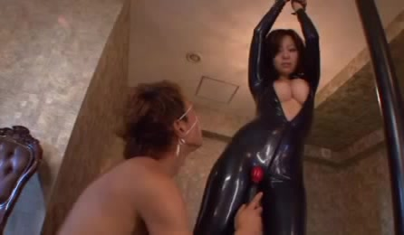 Hot Chick In Shinny Latex Costume Gets Her Clits And Tits Played With Vibrator