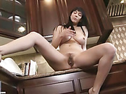 Alluring chick shows her sexy curves and big ass in the kitchen then takes off her purple bra and yellow panty printed with multi-colored flowers before spreading wide and masturbates beside the sink.