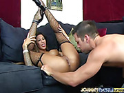 Brunette hottie displays her stunning body on a black couch wearing only her black fishnet stockings and black and white suspenders while letting a big dick drill in her pussy in different positions.