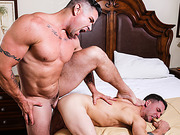 Inked cub deeply drills a twunk's ass in the bedroom.