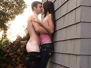Small-titted oriental girl giving head to a dude outdoors in the back yard