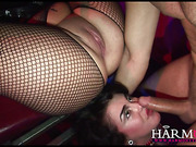 Female hand from a gloryhole fondling busty brunette's slit before hard anal threesome
