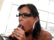 Busty ponytailed brunette in glasses sucking a big black dong before hard rimming on the stairs