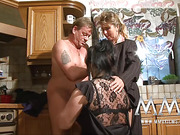 Plump brunette mature bitch in nylons and her ponytailed friend in 3some in the kitchen