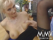 Blonde cougar in black stockings fucking with a younger guy in his office