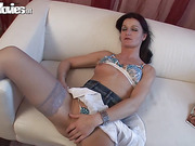 Minx in sexy stockings uses a high-end vibrator when pleasuring in an opulent setting.