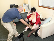 Heavenly hoe in black stockings and red heels gets primed for a fuckmachine.