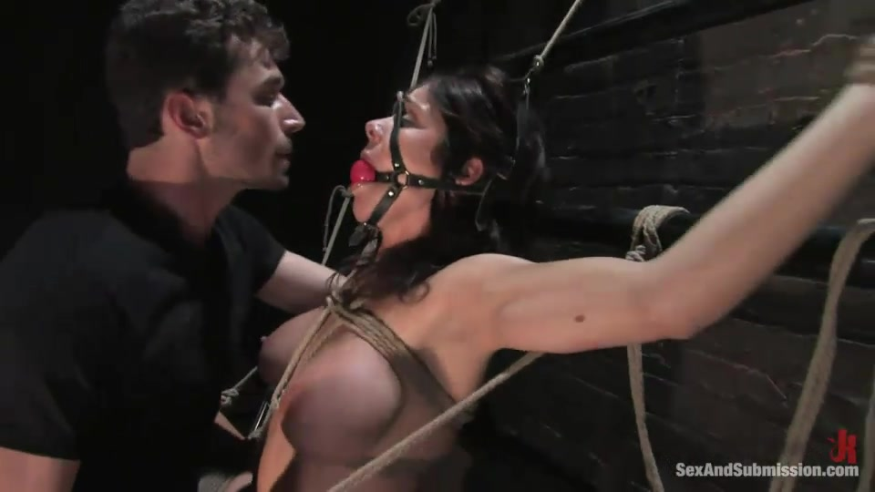 Brunette Buxom Kept In The Cage Gets Gagged And Roped To The Fence For Tough Sex