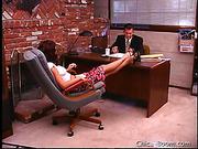 Hot brunette girl in white T-shirt gets banged on the desk in her boss' office