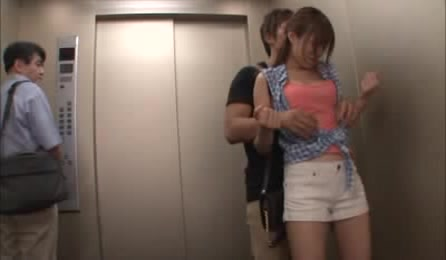Girl Rides Elevator With Unknown Hot Guy And Teases Him Until He Can't Take It