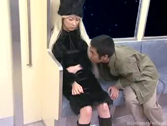 Blonde Asian Hottie Wearing Her Furry Black Hat, Dress And Boots Grabs A Stanger's Dick And Sucks It In A Train.