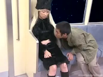 Lovely Blonde Rides A Train Wearing Her Furry Black Hat, Dress And Boots Then Sucks A Drunk Dude's Huge Dick.