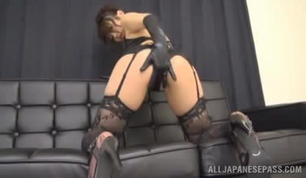 Lusty Asian Hottie Displays Her Luscious Body On A Black Couch Wearing Her Alluring Black Lingerie, Stockings And High Heels Before She Turns Around And Seduces With Her Sweet Ass.