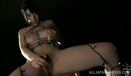 Banging Japanese Chick Pose Naked And Expose Her Luscious Tits And Hairy Pussy While Wrapped In Xmas Lights.