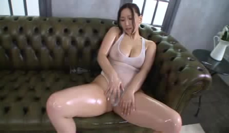 Sexy Asian Babe Bends Over And Shows Her Hot Butt Before She Spreads Her Legs Wide On A Green Couch And Shows Her Lusty Pussy Marking On Her White Leotard.