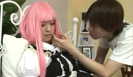 Lovely Japanese Chick Lets Her Handsome Boyfriend Touch Her Boobs And Rub Her Legs On A Blue Bed Wearing Her Pink Wig And Black And White Anime Dress.