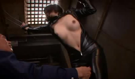 Lusty Asian Chick Gets Chained With Her Juicy Tits Exposed Wearing Her Black Leather Outfit While She Lets A Horny Dude Rub A Pink Dildo On Her Bushy Crack.