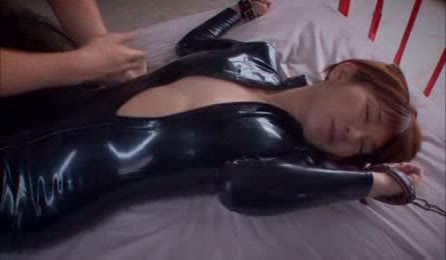 Foxy Hottie In Black Leather Outfit Gets Tied On A White Bed And Expose Her Juicy Boobs Before She Lets A Hot Stud Dip His Finger In Her Bushy Crack.