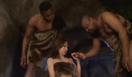 Pretty Asian Hottie Wearing Her Furry Cave Woman Outfit Goes Down And Suck Two Black Cavemen's Dicks Til They Blow On Her Face.