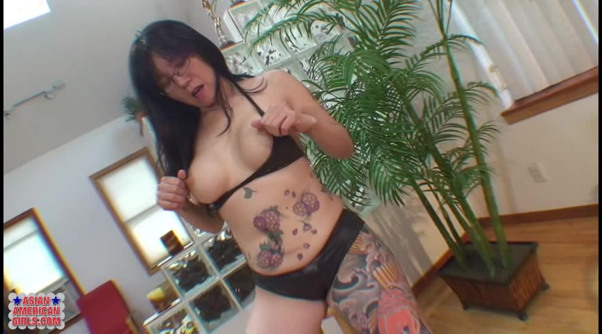 Tattooed Asian Milf Wearing Glasses And Platform Heels Spreads Her Pussy Wide