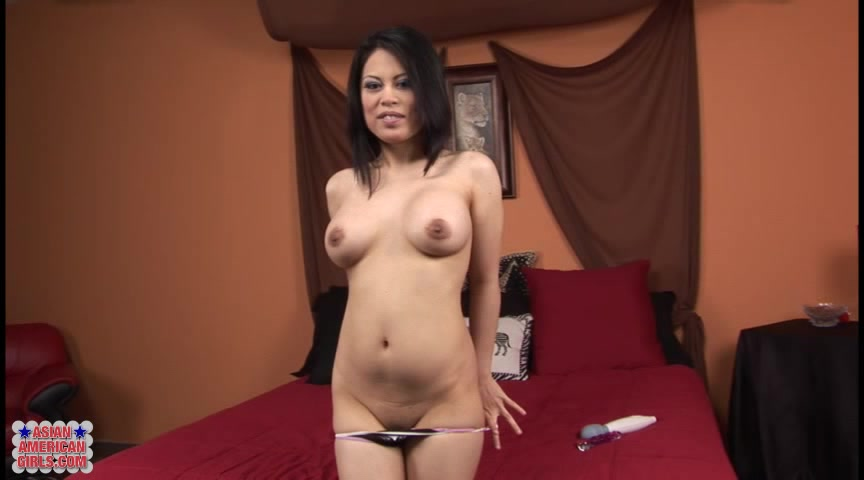 Short Haired Brunette Asian With Brown Eyes Fucks Herself With Glass Dildo