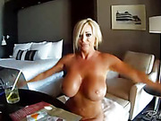 Sexy blonde woman goes naked and exposes her beautiful tits