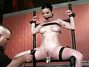 Foxy chick gets her head locked inside a metal sphere as she gets tied naked on steel bars before she gets her hot boobs squeezes with metal pins while getting her lusty pussy vibrated before she gets strapped on different bars then gets gagged by a black